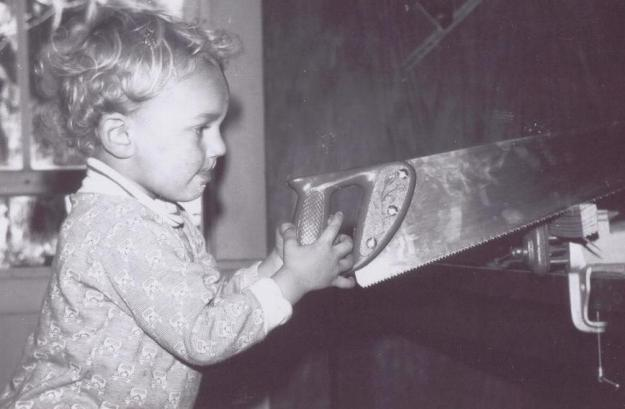 One of the children learning to saw in the real world